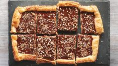 CHOCoLATE CARAMEL PECAN TART  - Store-bought puff pastry keeps the prep time for this tart to a minimum. Inspired by turtle candies, the filling is rich, nutty, and chewy.