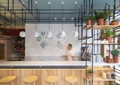 A spine of steel framework runs the length of this Greek restaurant in London by Athens designers k-studio.