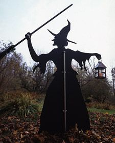 Halloween: Witch lawn ornament (rear view). 6' plywood cut-out. Martha Stewart. Wouldn't this be cute if the witch were holding a tea kettle instead of a lantern?