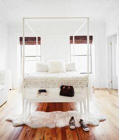 clean bedroom, white wash, wood floors, + fur rug