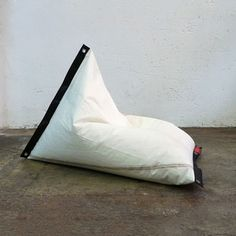 Brilliant use for old sails! Beanbag chairs for the beach!                  Genois LTD Mainsail Cover Black now featured on Fab.
