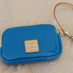DOONEY &BOURKE WRISTLET Blue patent leather wristlet with outside I d compartment and Xtra inside Never used Dooney & Bourke Bags Clutches & Wristlets