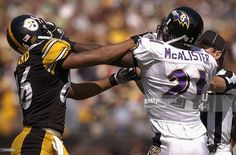 Wide receiver Hines Ward #36 of the Pittsburgh Steelers fights with cornerback Chris McAlister of the Baltimore Ravens on September 7, 2003 at Heinz Field in Pittsburgh, Pennsylvania. The Steelers defeated the Ravens 34-15.