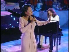 Yanni- Love Is All    This is a must see.  Vann Johnson's voice is incredible and the images of the Taj Mahal in the video are breathtaking.