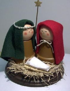 Nativity  Made with 2 small flower pots painted gold, 2 wooden knobs, some fabric, straw, and thread on a piece of wood you can get at any craft store... beautiful
