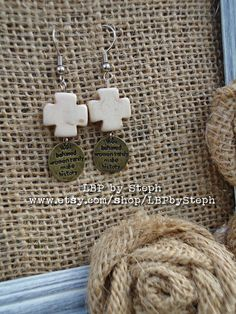 Well Behaved Women Rarely Make History Dangles with Cream Cross. $7.50, via Etsy.