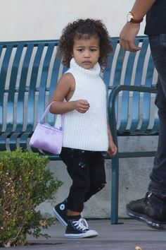 North West toting a pink satin purse on a shopping trip with Penelope Disick.