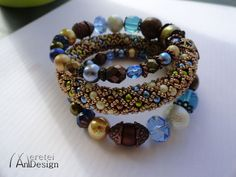 Blue brown and gold multicolor handmade romantic beadwork bracelet on flexible memory wire universal size as a Cristmas present by MereteiAndesign on Etsy Blue Brown, Beadwork, Jewelery, Beaded Bracelets, Beads, Unique Jewelry, Handmade Gifts, Gold, Wire