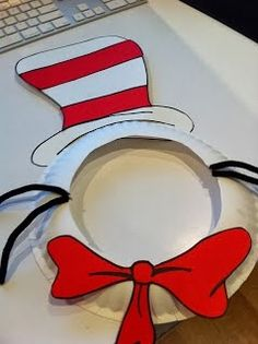 You'll need:   -a paper plate   -black pipe cleaners   -white cardstock   -red paper   -scissors   -glue   -a black marker        Ar...
