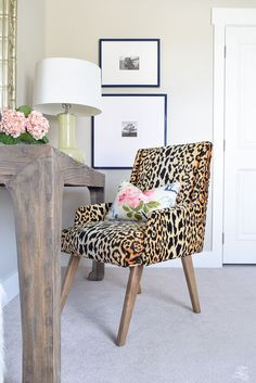 Chic work space boasts a leopard print chair in Tonic Home Bianca Fabric lined with an Eastern Charms Hibiscus Pillow paired with a salvaged wood desk topped with a yellow green lamp. Leopard Print Chair, Leopard Print Bedroom, Animal Print Bedroom, Leopard Bedroom Decor, Leopard Pillow, Office Paint Colors, Interior Design Gallery, Bedroom Retreat, Guest Bedrooms