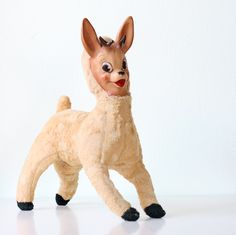 stuffed animal reindeer (with rubber face)  ..tag says copyright 1959, Columbia Toy Products