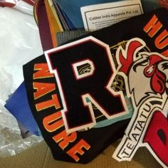 Check out LetterSports.com for discounted fully customized chenille patches & embroidery.
