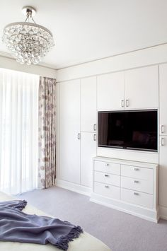 Spotlight On Blair Harris Interior Design...I like the closet space mixed with the TV, we totally have room for this.
