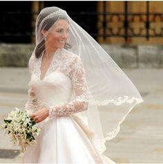 Princess Kate wore a tiara and a veil Google Image Result for http://theweddingtiara.com/wp-content/uploads/2011/05/Kate-Middletons-Wedding-Tiara.jpg