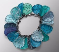 Bracelet   Carol Windsor. Formed by laminating sterling silver between layers of very thin paper.~~
