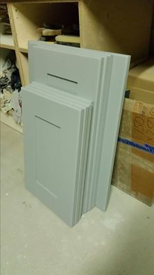 The batch of doors from the island primed. These require minimul filling before top coats...