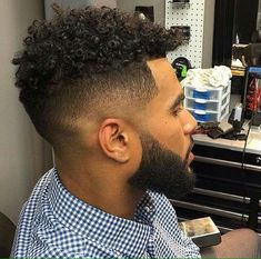 Black man with curly hairstyle & beard