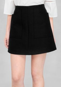 Dense and soft cotton twill is crafted into this flirty mini skirt with two large patch pockets on sides.