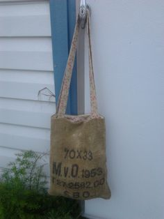 Purse made out of old burlap bag. Found on Facebook at Crafty Recycling by D.