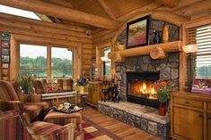 Be inspired to design your own custom wood home. Take a tour of the Prairie Song by Expedition Log Homes Log Cabin Living, Log Cabin Homes, Log Cabins, Mountain Cabins, Wooden Cabins, Cabana, Beautiful Tree Houses, Fireplace Pictures, Log Home Interiors