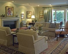 traditional living room set up in front of fireplace