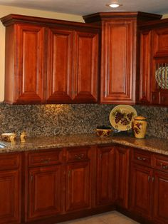 This is an example of a counter and backsplash that I DON'T want.  Too busy.  Kitchen Cherry Cabinets | Cherry Kitchen Cabinets Home Design traditional-kitchen-cabinets