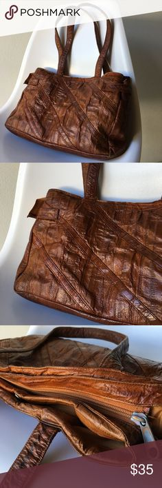 """Vintage Handbag 👜 Vintage Handbag Made of Eel Skin  Beautiful Burnt Camel Brown 🐫 with shine.  Dimensions 13"""" x 8"""" x 2""""  See photos discoloration shown on Zipper and 2 silver side snaps. Inside has a few spots as well. None of these effect use as it looks great on! Vintage Bags Shoulder Bags"""