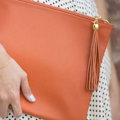 Brighten up your summer look with clutches and bags in fun pops of color!