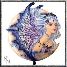 This beautiful fairy in the moon wall plaque hand painted with her wings in lilacs, blues and deep purple.