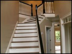 Stairs after hardwoods and painted handrail