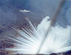 """Plane drops a white phosphorus bomb on a Viet Cong postion in 1966. (USAF)"" i.e. a Vietnamese village that might or might not be Viet Cong. White phosphorous continues to pose a danger to villagers and back packers to war ravaged Vietnam, Laos and Cambodia. ~ Vietnam War"