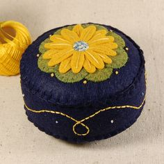 Blue and Gold Hand Embroidered Daisy Pincushion by TheBlueDaisy, via Flickr