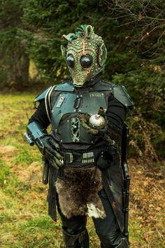 A Rodian in Mandalorian Armor