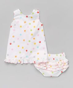 Footloose and fancy-free, this cottony frock and diaper cover will keep everything under wraps as little ones scoot about in comfort. This set's perfectly patterned silhouette slips on with ease, making changing a no-fuss no-muss affair.
