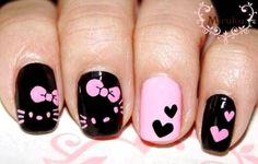 Pretty pink Hello Kitty nail art design..