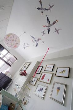 Evelyn's Enchanted Ceiling Room -- I really like the ceiling mural + cute picture wall of simple early Andy Warhol illustrations.