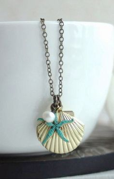 Starfish and Shell Brass Locket Necklace.