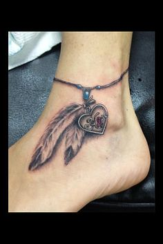 feather and locked anklet tattoo