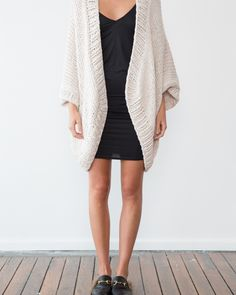 This kimono style cardigan is a nice variation on our long sleeved cardigans and an easy throw on for warmer weather. It has an oversized and relaxed fit, hand knitted in pure pima cotton yarn and available in 8 different colors. It has an open front and ribbed trim. Hand knitted with 100% pure Pima …