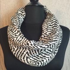 Big Buddha Zebra Print Fashion Infinity Scarf Zebra print infinity scarf, some snags in the material creating imperfections in the print. Overall, great condition! Big Buddha Accessories Scarves & Wraps