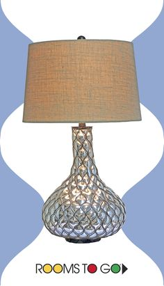 Add vintage-inspired warmth to a living space or bedroom with the textural and tactile Gage table lamp.