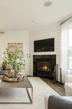 Textural elements combined with crisp shiplap lend powerful, yet subtle dimension to this cozy corner, created by @mihomes. Our best-selling  SlimLine series gas fireplace fits snugly in even the tightest spaces, making it a favorite among builders and remodelers alike.