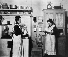Kitchen servants, c. 1910. My favorite part is how many things I don't recognize in this photo. Like everything on the wall between the two women.