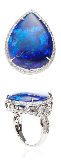 This ring by Gioia features a pear shaped black opal surrounded by encrusted diamonds and set in 18K white gold.
