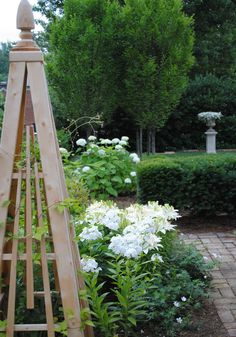 Obelisk - love the strong angles contrasting with the flowers. The white phlox is a show stopper here Moon Garden, Dream Garden, Home And Garden, Garden Art, Modern Garden Design, Landscape Design, Unique Gardens, Beautiful Gardens, Wood Trellis