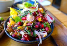 An orange, date and radish salad garnished with pomegranate seeds...