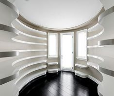 One Of The Homes Entrances Features A Curved Shoe Rack Display For Kylies Large Collection