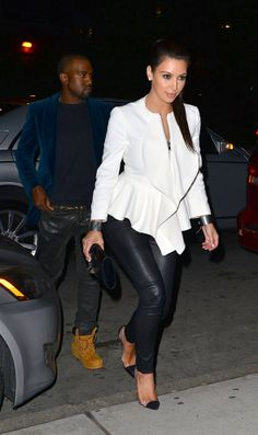 Kim Kardashian rocks a fresh white #peplum jacket with #leather pants.