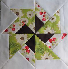 Quilt block by heidielliott - like the dark inner pin wheel.