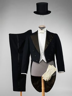Man's evening suit, by Brooks Brothers, American, 1947.This set of evening coordinates is unusual in its completeness. Made by Brooks Brothers, a well-known high-quality American menswear maker, it features an unusual piqué pattern on vest. The mock-front and real center-back-button closure of the shirts makes for cleaner, smoother look.